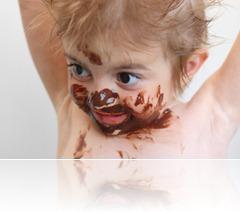 child eating chocolate